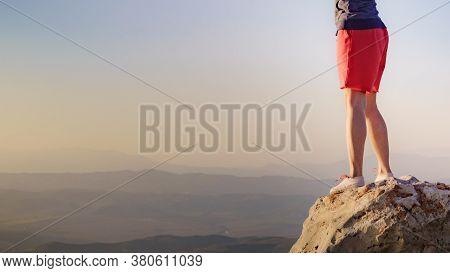 Tourist Woman Legs On Rock Viewpoint Enjoying Sunset Landscape. Mesa Roldan Location In Province Alm