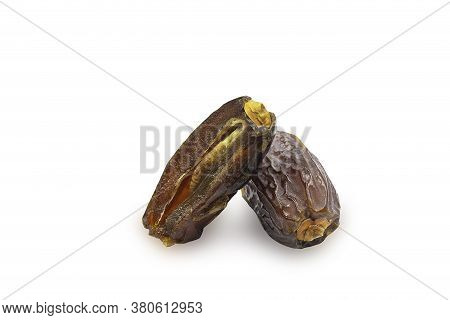 Dried Medjoul Date Fruit On White Isolated Background With Clipping Path. Dates Palm Is Food For Ram