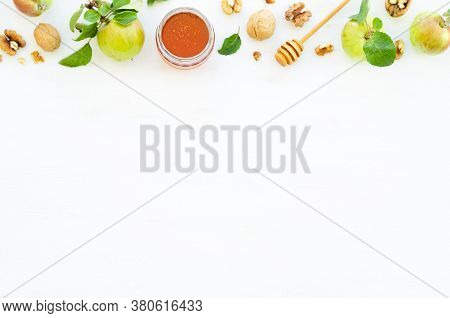 Honey, Apples And Walnuts On White Wooden Background. Overhead Food Shots. Copy Space Composition