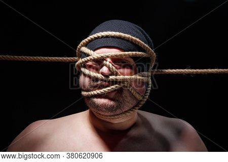 Image Of Binded Fat Man With Rope On Face
