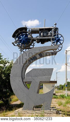 The First Soviet Tractor Of The Twentieth Century. A Monument Of History On The Soviet Symbolism Ham