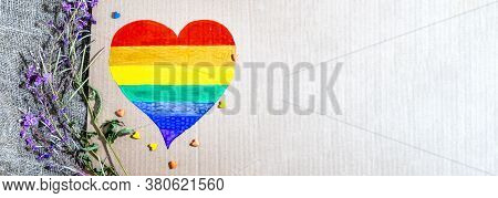 Heart With Lgbt Gay Rainbow Flag On Linen Cloth Background. Multicolored Heart In The Gay Pride Flag