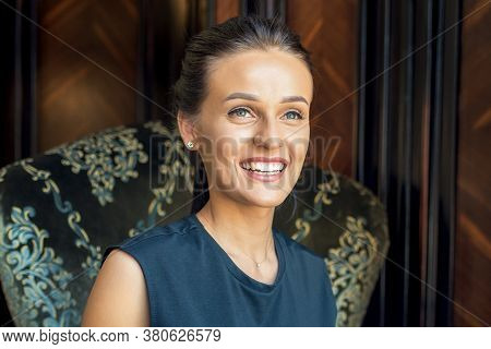 Portrait Of Smilng Business Woman Sitting On Armchair Indoor. Stay Home And Quarantine Concept.