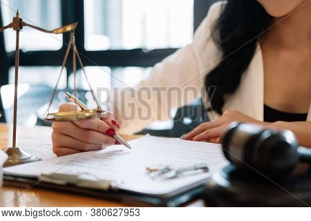 Judge Gavel With Justice Lawyers, Business Woam In Suit Or Lawyer Working On A Documents. Legal Law,