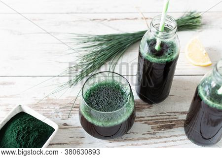 Spirulina Drink And Spirulina Algae Powder On White Wooden Table. Superfood, Detox Drink.