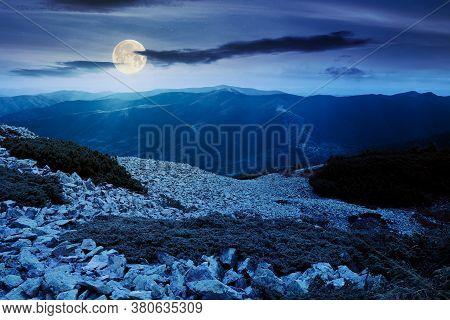 Mountain Landscape With Stones At Night. Juniper Tree Among The Rocks And Grass. Dramatic Nature Sce