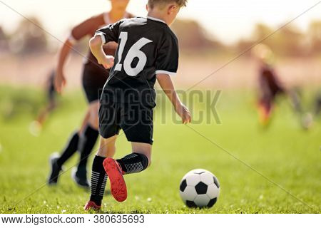 Kids In Soccer Club. Sports Summer Training Camp For School Children. Sports Summer Activity For Jun