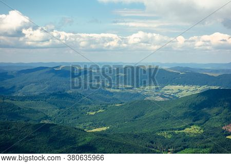 Mountain Landscape On A Summer Day. Hills Rolling From The Valley Up In To The Distant Ridge. View O