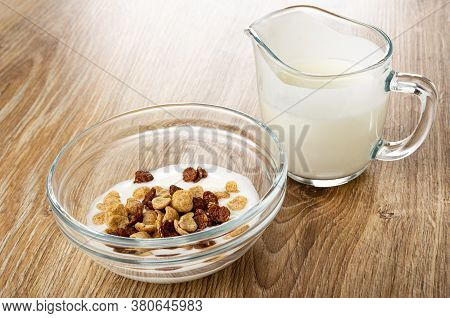 Cereal Grains Breakfast With Chocolate And Caramel In Glass Bowl With Yogurt, Transparent Pitcher Wi