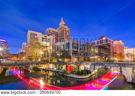 San Antonio, Texas, USA skyline on the river walk at dusk.