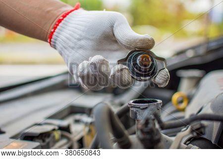 Transparent White Gloves. Handle. Car Radiator Lid Opens.