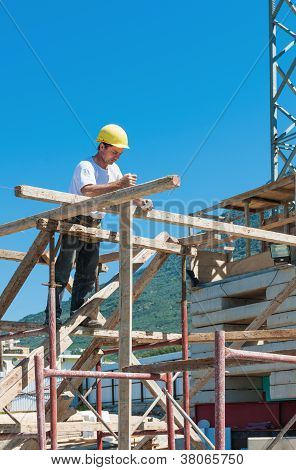 Construction Worker On Scaffold