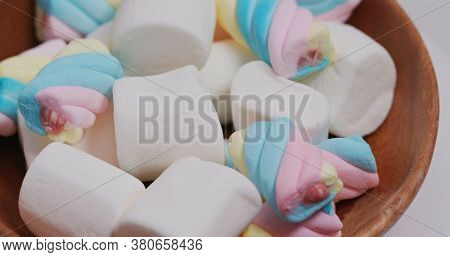 Sweet candy Marshmallow on wooden plate