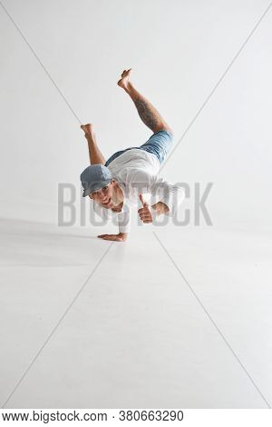Cool Smiling Guy Breakdancer Dancing Lower Break Dance Shows Thumbs Up Isolated On White Background.
