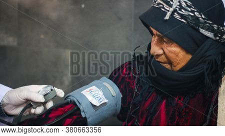 Aleppo, Syria, January 15, 2020:\na Modern Rehabilitation Physiotherapy Worker With Senior Client