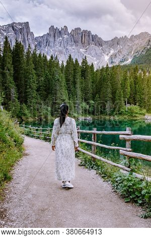 Woman Visit Hte Bleu Lake In The Dolomites Italy, Carezza Lake Lago Di Carezza, Karersee With Mount