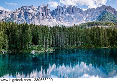 Bleu Lake In The Dolomites Italy, Carezza Lake Lago Di Carezza, Karersee With Mount Latemar, Bolzano