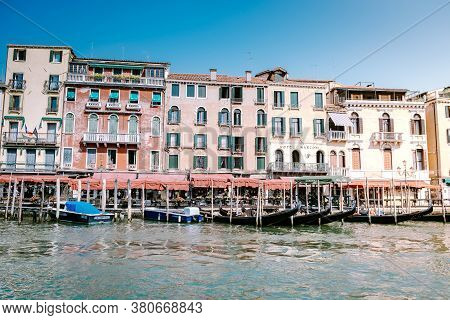Venice Italy July 2020, Venetian Gondolier Punting Gondola Through Grand Canal Of Venice, Italy. Gon