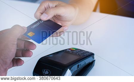 People Who Pay At The Counter Pay Him Using Credit Cards, Shopping Areas And Convenience Retail Conc