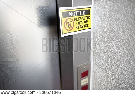 Yellow Elevator Out Of Service Notice Sign Attached To Elevator Door, Digital Composite
