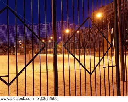 Sports Ground At Night In Winter Behind A Fence, Moscow