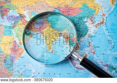 Bangkok, Thailand - August 01, 2020 India, Magnifying Glass Close Up With Colorful World Map
