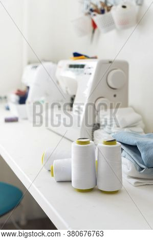 Sewing: Several Large Skeins Of White Thread For Sewing Machines On The Tailors Desk.