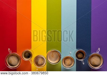 Row Of Thermo Glass Cups With Fresh Black Espresso And Americano Coffee. Colorful Striped Background