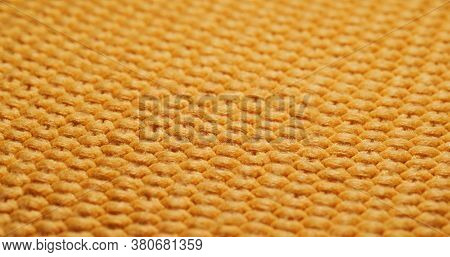 Yellow knitted duvet texture close up