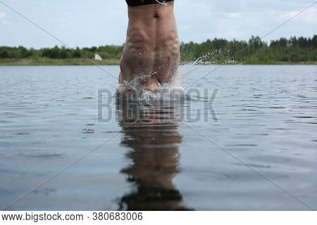 Man jumps into the lake