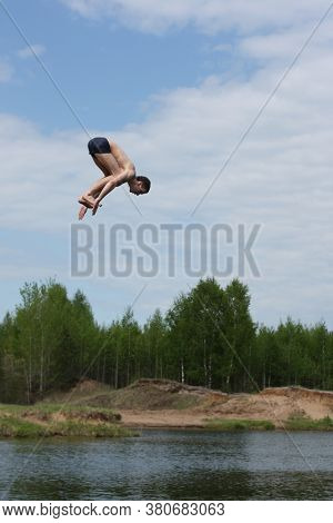Man jumps into the lake and flies high in the sky