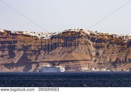 Greece, Santorini, Septenber, 2012 - Ocean Liner Near Santorini Island In Aegean Sea, Greece
