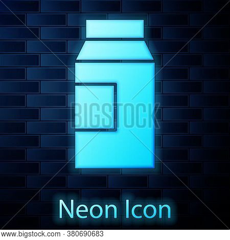 Glowing Neon Paper Package For Milk Icon Isolated On Brick Wall Background. Milk Packet Sign. Vector