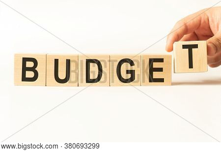 Budget Word Wooden Cubes On White Background. Money Annual Budget Concept