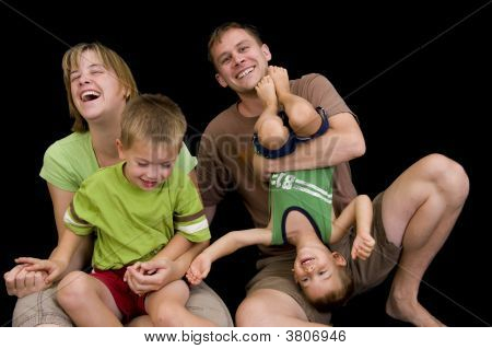 Adorable Young Family Playing