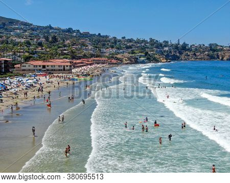 Aerial View Of La Jolla Bay With Nice Small Waves And Tourist Enjoying The Beach And Summer Day. La