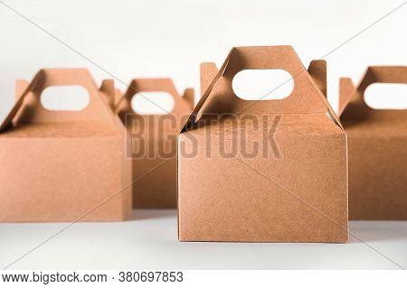 Cardboard Boxes On A White Background. Ecological Packaging Of Paper Products Close-up And Copy Spac