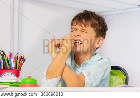 Sad Boy With Autistic Disorder Breaking Hands And Fingers In Negative Expression Behavior During Dev