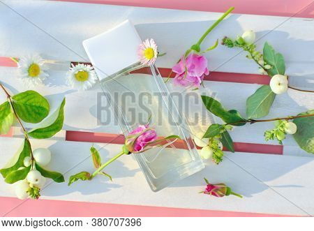Floral Perfume Bottle With White And Pink Flowers On White Wooden Tray. Unbranded Perfum For Flowers