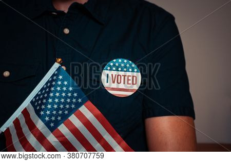 Anonymous Man With Election Campaign Vote Pin And The Usa American Flag.