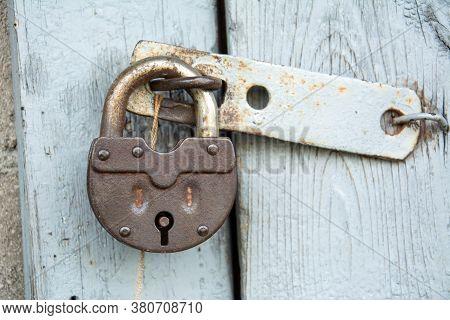 Closeup Steel Door With Lock , Padlock , Key Lock. Padlock On Old Door.
