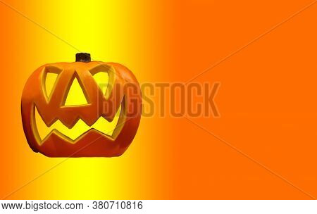 Jolly Jack O Lantern From A Pumpkin, On A Graded Background. Halloween, Decoration And Horror Concep