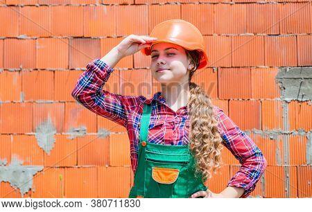 Girl In Helmet Is Construction Worker. Foreman Teen Child. Kid Work In The Helmet. Little Girl In A