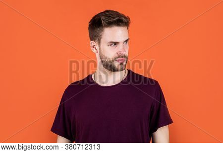 Facial Care. Sexy Man Wearing Purple Clothes Posing In Studio. Good Confident Young Man Standing In