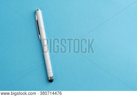Capacitive Touchscreen Stylus On Blue Background. Copyspace. Closeup