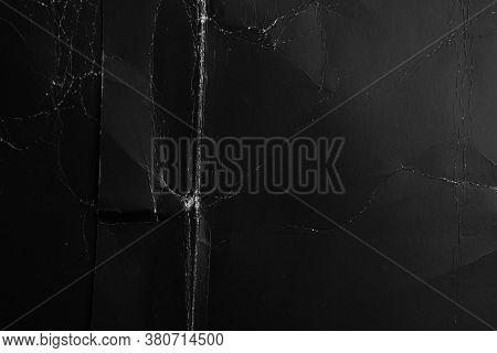 Folded Black Crumpled Paper. Dusty Shabby Material