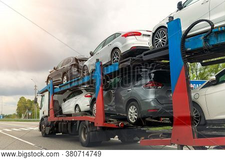 Tow Truck Car Carrier Semi Trailer On Highway Carrying Batch Of Damaged Cars Sold On Insurance Car A