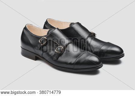 Male Classic Shoes. Elegant Black Monk Shoes Isolated On Grey Background
