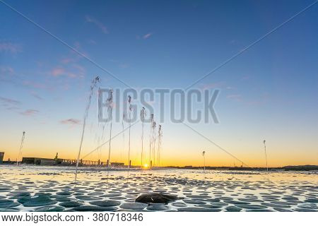 Water Feature With Spraying Water On Tauranga Strand Waterfront At Sunrise With Clear Blue Sky, New