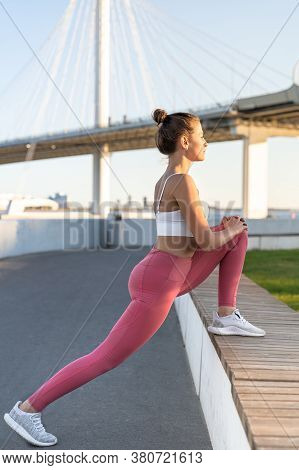 Athletic Woman In Pink Leggings Stretching Muscles Making Functional Training, Doing Exercises For L